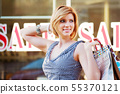 Happy young woman with shopping bags 55370121