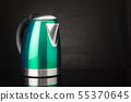 Green stainless steel kettle on black background 55370645
