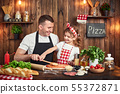 Beautiful daughter helping dad to spread sauce while cooking pizza 55372871