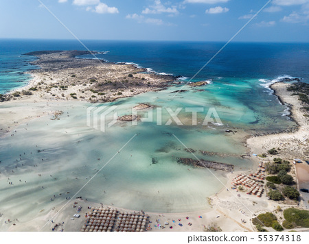 Aerial photo of Caribbean like beach with turquoise water and pink sand 55374318
