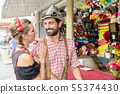 Man in Bavarian Tracht at a shooting gallery on local fair 55374430