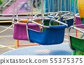 closeup of carrousel chairs in attraction park 55375375