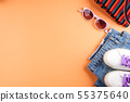 Fashion flat lay with jeans and glasses on orange 55375640