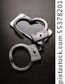 mobile phone and handcuffs 55378201