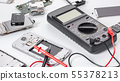 disassembled mobile phone and tools 55378213