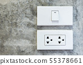 Switch and socket on concrete wall. 55378661