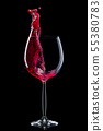 Glass for red wine with splashes isolated on black background. 55380783