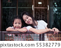 Asian mother and her mother smile at home 55382779
