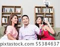 Friends taking selfie on cellphone 55384637