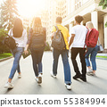 College students walking together outdoors after studies 55384994