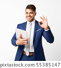 Young Businessman Holding Digital Tablet And Gesturing OK, Isolated 55385147