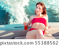 Beautiful red-haired girl relaxing in a pleasure boat 55388562