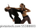 Man and woman fighting in studio, women's self-defense concept 55388603