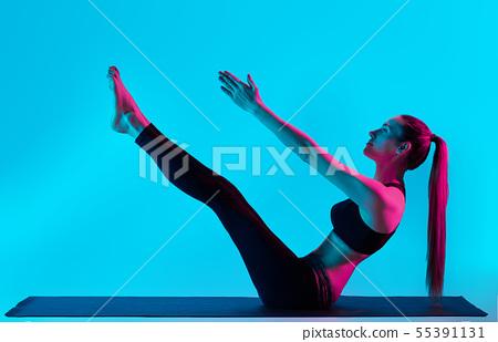 woman yoga exercices Navasana boat pose 55391131