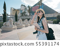 photographer with travelers guide book outdoor 55391174