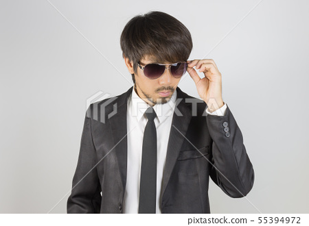 Portrait Businessman in Black Suit Touching 55394972