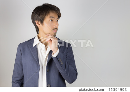 Portrait Man in Navy Blue Suit Looking Above and 55394998