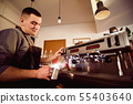 Barista making pattern in a cup of coffee shop. 55403640
