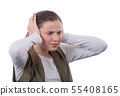 Young teenager girl with hands covering his ears 55408165