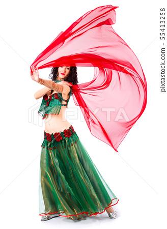 A woman in a green dress Oriental dancer dancing erotic dancer 55413258
