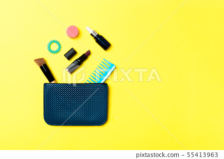 Make up products spilling out of cosmetics bag, on 55413963