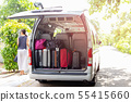 Van with luggage on a sandy with woman in blur background travel concept. 55415660