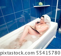 Relaxing in the bathroom with wine 55415780