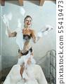 Cheerful woman having fun with foam in bathtub 55419473