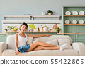 Pretty girl relaxing at home and enjoying her free 55422865
