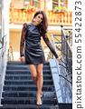 Seductive lady in short leather dress descending 55422873