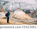 Stepantsminda, Gergeti, Georgia. Man Tourist Backpacker Traveler Photographer Taking Pictures Photos 55423061