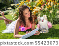 Beautiful girl with a small dog Chihuahua in the park 55423073