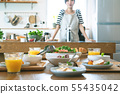 Morning dinner table with woman 55435042