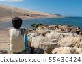 woman looking at the ocean near the Dune du Pilat 55436424