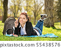 Student in a park talking on the phone 55438576