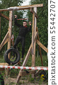Man passing through hurdles during obstacle course in boot camp 55442707
