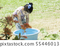 Portrait of a  little girl playing with hose and 55446013