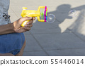 Plastic bubble makers gun in young teenage hand in 55446014