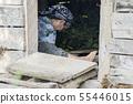 Muslim woman feeding silkworms by leaves inside 55446015