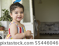 Close-up portrait of a happy little girl holding 55446046
