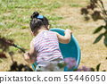 Backside of little girl playing with hose and blue 55446050