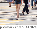people crossing the street at pedestrian crossing 55447024