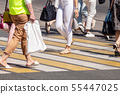 feet of pedestrians walking on the crosswalk 55447025