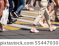feet of pedestrians walking on the crosswalk 55447030