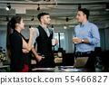 Businessmen are brainstorming in the meeting room. 55466827