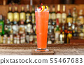 The cocktail is on the bar 55467683