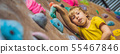 little boy climbing a rock wall in special boots. indoor BANNER, LONG FORMAT 55467846