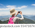 Asian climbing woman take pictures 55473074