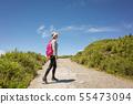 Asian mountain climbing woman walking 55473094