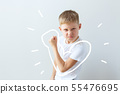 Child shows his force in the bent hand. Muscles 55476695